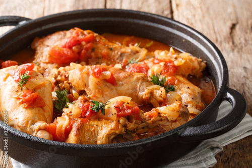 Cunillo stew of rabbit in tomato sauce with white wine and herbs close-up in a pan Canvas Print