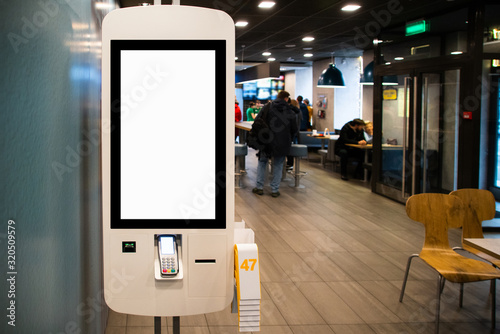 Photo Self-service desk with touch screen in fast food restaurant