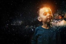 A Small Child Whose Light Shines In His Forehead. He Imagines Himself An Astronaut