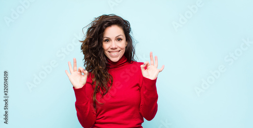 young pretty woman feeling shocked, amazed and surprised, showing approval makin Canvas Print