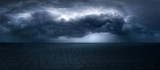 dark and dramatic stormy clouds over sea