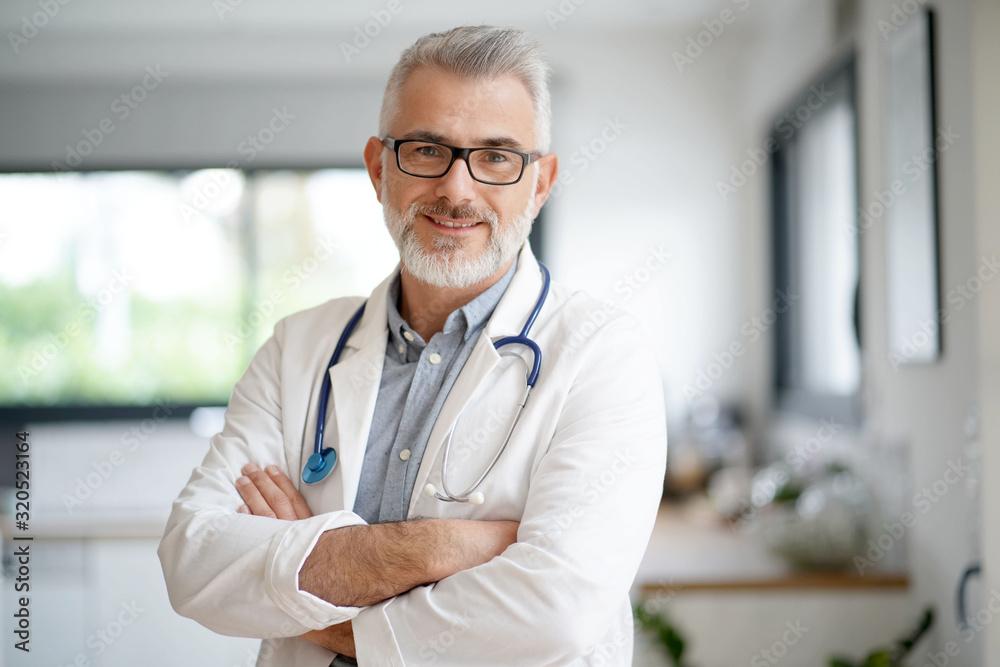 Fototapeta Portrait of mature doctor with eyeglasses