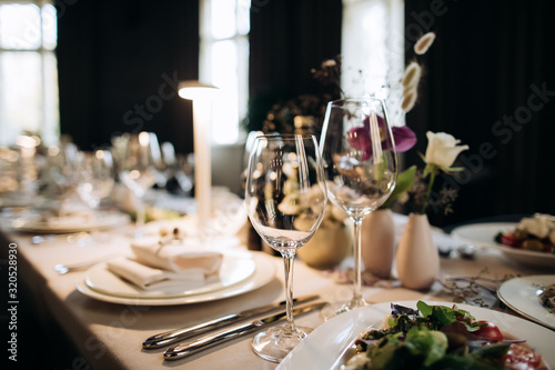Elegant table set  for a romantic dinner. Catering, hospitality and private dining