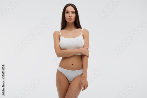 Fototapeta Sensual woman in underwear looking at camera alluringly obraz na płótnie