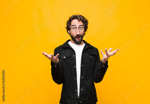 young crazy handsome man open-mouthed and amazed, shocked and astonished with an Wallpaper Mural