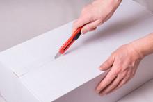 Man Hands Opening Cardboard Bo...