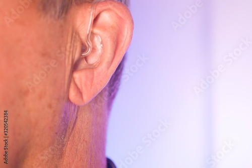 Photo Man with hearing aid