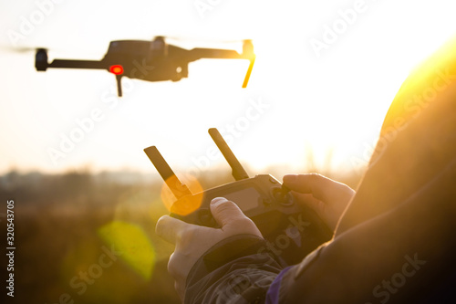 Photo Man Operating drone remote controller.