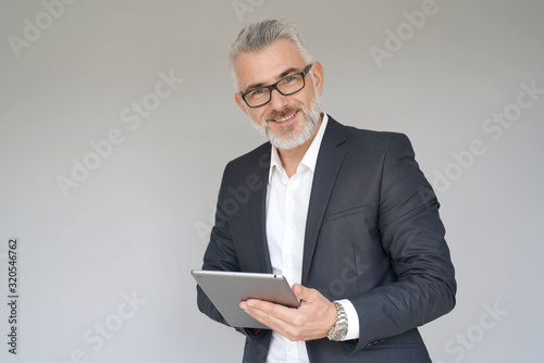 Fototapety, obrazy: Businessman using digital tablet, isolated