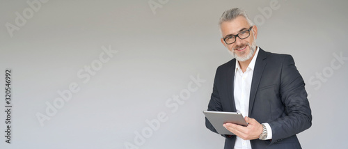 Obraz na plátně Businessman using digital tablet isolated on background- template