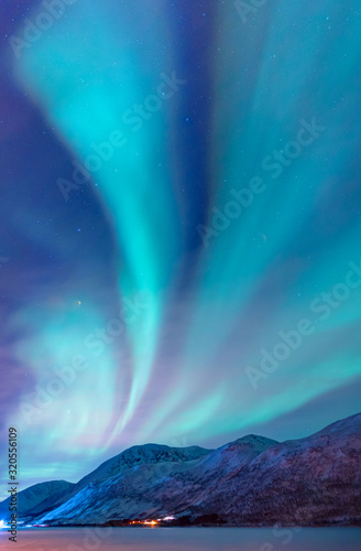 Northern lights (Aurora borealis) in the sky over Tromso, Norway Fototapeta