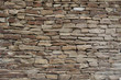 Stone wall. Texture of evenly laid stones.