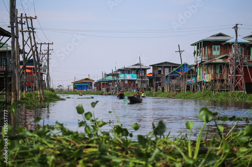 Houses on stilts in the floating village of Inle Lake, Myanmar Canvas Print