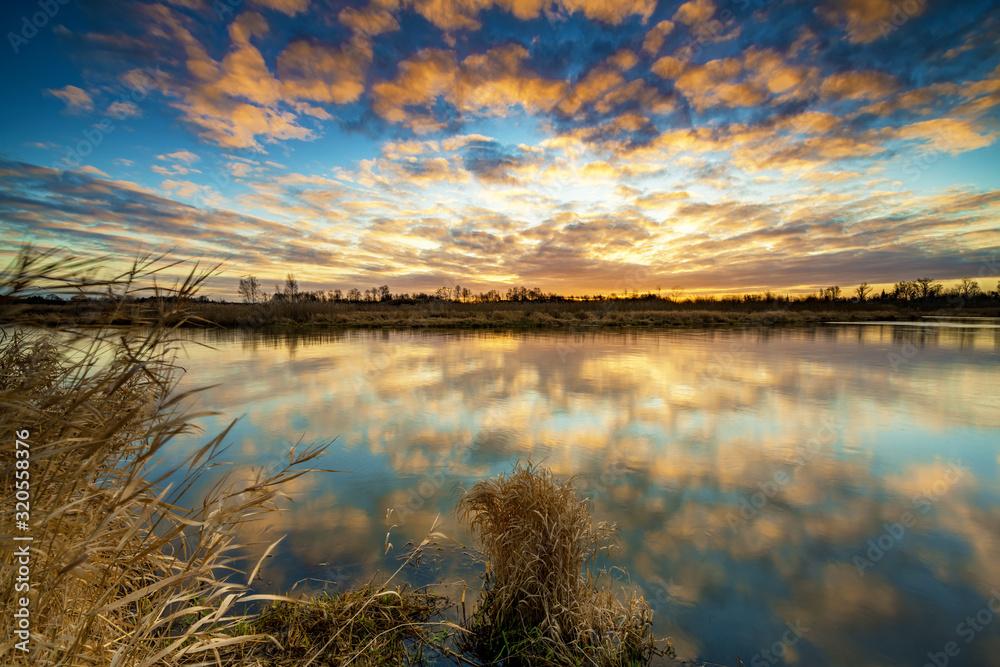Fototapeta Beautiful sunrise over river banks