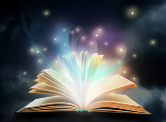 Open book with fairytales and magic lights. Creative design