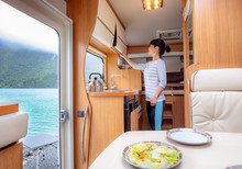 Woman Cooking In Camper, Motor...