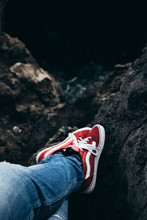Red Vans Trainer On The Rock