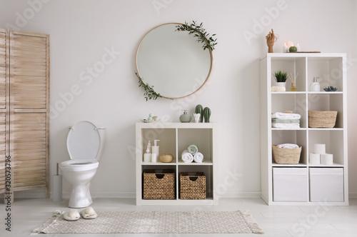 Interior of modern bathroom with round mirror Fototapet