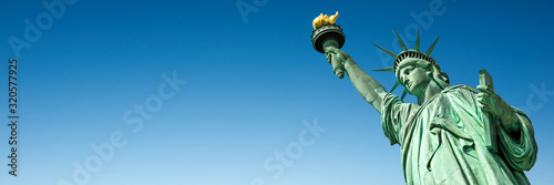 Foto Murales Statue of Liberty in New York, USA. Blue sky panoramic background with copy space