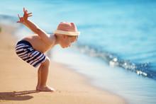 Boy Walking At Sea In Straw Hat