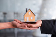 Real estate agent hands offer house to buyer. Business mortgage, property loan, house insurance, business investment concept