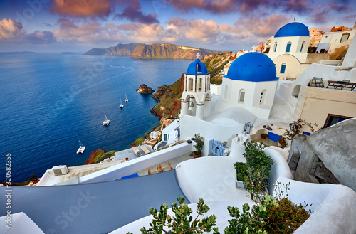 Fototapeta Fira town on Santorini island, Greece. Incredibly romantic sunrise on Santorini. Oia village in the morning light. Amazing sunset view with white houses. Island of lovers obraz