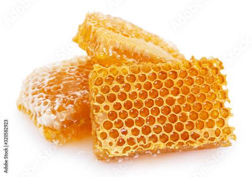 Photo Honeycomb with honey on white background