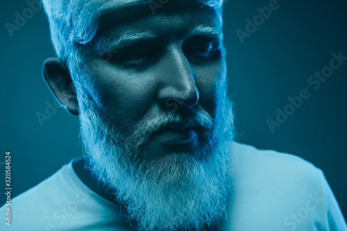 Calm albino man under blue illumination Wallpaper Mural