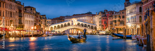 Canvas Romantic gondola ride near Rialto Bridge in Venice, Italy