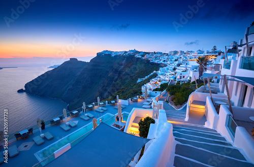 Fototapeta Fira town on Santorini island, Greece. Incredibly romantic sunset on Santorini. Oia village in the morning light. Amazing sunset view with white houses. Island lovers. obraz
