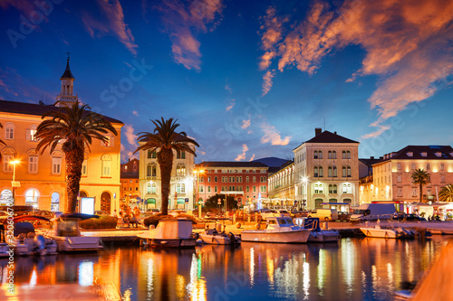 Split, Croatia. View of Split - the second largest city of Croatia at night. Shore of the Adriatic Sea and famous Palace of the Emperor Diocletian. Traveling concept. Mediterranean countries.