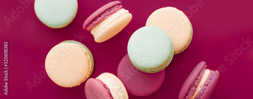 French macaroons on cherry pink background, parisian chic cafe dessert, sweet food and cake macaron for luxury confectionery brand, holiday backdrop design