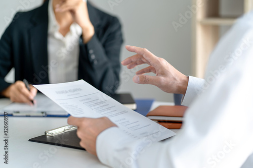Candidate with resume at job interview with human resource, Recruitment concept.