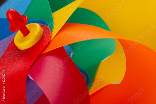 colorful plastic windmill pinwheel Tablou Canvas