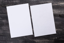 White Paper On Wood Background...