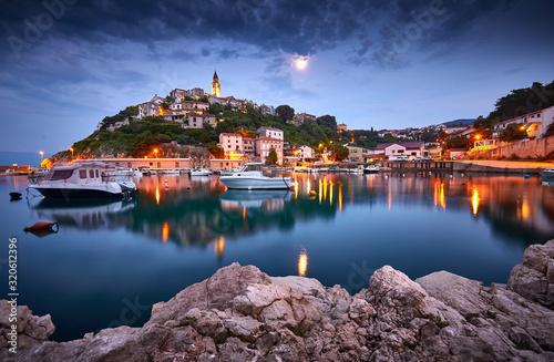 Town of Vrbnik (Verbnik) harbor view morning glow, Island of Krk, Kvarner bay archipelago, Croatia, Europe. Dramatic summer seascape of Adriatic sea. Stone beach. Incredible evening cityscape.