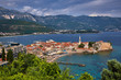Aerial panoramic view of Old town Budva: Ancient walls and red tiled roof. Montenegro, Europe. One of best preserved medieval cities in the Mediterranean and most popular resorts of Adriatic Riviera..