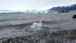 Pieces of ice on the shore from melting icebergs of Jokulsarlon glacier lagoon, Iceland. Global warming and climate change concept