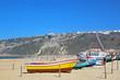 Leinwanddruck Bild - Traditional fishing boats on Nazare Beach, Portugal