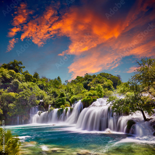 Beautiful Skradinski Buk Waterfall In Krka National Park - Dalmatia Croatia, Europe. Beautiful long exposure panorama of waterfalls (milk effect). A true natural wonder. Amaizing sunlight view. - 320618779