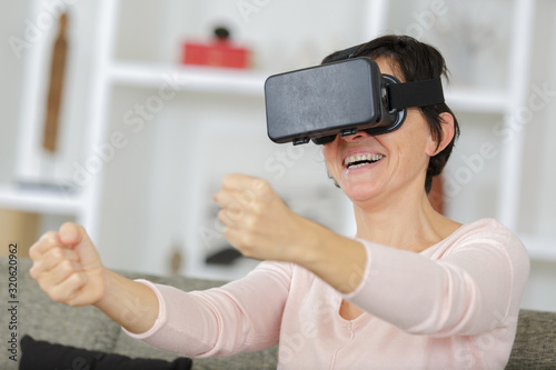 Fototapeta a happy woman experiencing virtual reality obraz