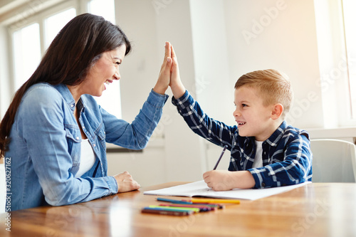 Fototapeta homework teaching boy high five education mother children son familiy childhood