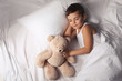 canvas print picture Little boy sleeping with teddy bear at home. Bedtime