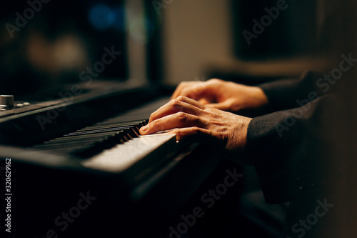 Hands of pianist playing synthesizer close-up Canvas