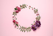 canvas print picture - Frame made of beautiful flowers on pink background, flat lay with space for text. Floral composition