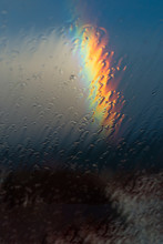 Raindrops On Roof And Rainbow In Summertime