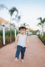 Ethnic Kid Walking Barefoot In...