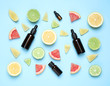 canvas print picture Flat lay composition with bottles of citrus essential oil on light blue background