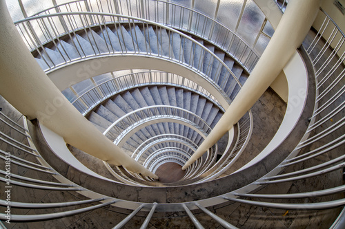 Fototapety, obrazy: A staircase in Germany with columns and flooded with light from the 1950s with stairs down