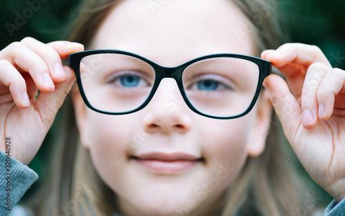 Cuadros en Lienzo Closeup portrait of little girl  with myopia correction glasses